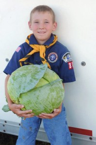 Boy Scout holding a cabbage